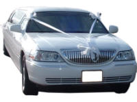 Cars for Stars (Guildford) - Wedding Limo. White Lincoln stretched wedding limousine with white ribbons